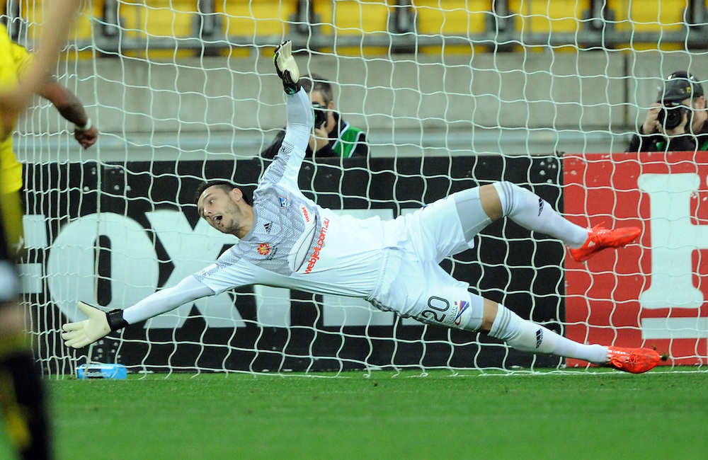 Sydney FC's Vedran Janjetovic saves a penalty attempt by the Phoenix in the A-League football match at Westpac Stadium, Wellington, New Zealand, Sunday, April 26, 2015. Credit:SNPA / Ross Setford