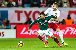 November 13, 2017 - Gdansk, Poland - Artur Jedrzejczyk (POL), Javier Aquino (MEX)  during the International Friendly match between Poland and Mexico at Energa Stadium in Gdansk, Poland on November 13, 2017. (Credit Image: © Foto Olimpik/NurPhoto via ZUMA Press)