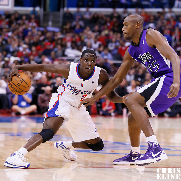 23 November 2013: Los Angeles Clippers point guard Darren Collison (2) goes for the crossover against Sacramento Kings small forward Travis Outlaw (25) during the Los Angeles Clippers 103-102 victory over the Sacramento Kings at the Staples Center, Los Angeles, California, USA.