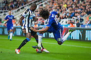 Newcastle United Chancel Mbemba makes a vital tackle on Chelsea FC Loic Remy during the Barclays Premier League match between Newcastle United and Chelsea at St. James's Park, Newcastle, England on 26 September 2015. Photo by Craig McAllister.