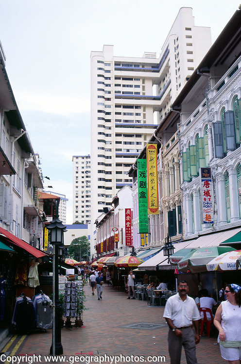 High rise modern apartment block rising above traditional buildings in Chinatown, Singapore