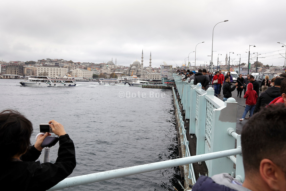 Galata bridge with view towards the old city and Yeni Camii mosque Istanbul Turkey