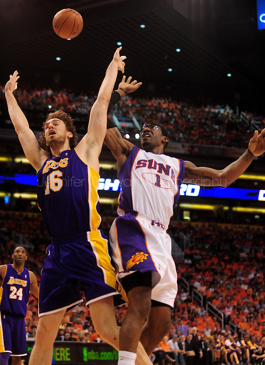 May 29, 2010; Phoenix, AZ, USA; Phoenix Suns forward Amare Stoudemire (1) puts up a shot against Los Angeles Lakers forward Pau Gasol (16) during the first quarter in game six of the western conference finals in the 2010 NBA Playoffs at US Airways Center.  Mandatory Credit: Jennifer Stewart-US PRESSWIRE
