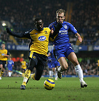 Photo: Lee Earle.<br /> Chelsea v Wigan Athletic. The Barclays Premiership.<br /> 10/12/2005. Chelsea's Arjen Robben (R) battles with Pascal Chimbonda.