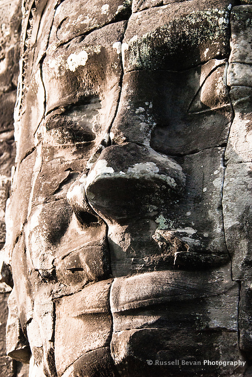 A smiling stone face at The Bayon temple in the walled city of Angkor Thom, Siem Reap, Cambodia