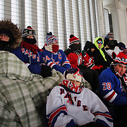 Fans dressed for the weather on a bitterly cold day at Yankee Stadium during the New York Rangers Vs New Jersey Devils NHL regular season game held outdoors at Yankee Stadium, The Bronx, New York, USA. 26th January 2014. Photo Tim Clayton
