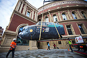 UNITED KINGDOM, London: 26 February 2018 <br /> A 23 foot Lancaster Bomber replica is carefully lowered in front of The Royal Albert Hall this morning to mark the 75th anniversary since 'Operation Chastise' was given final approval. It also comes before a gala screening of The Dam Busters which will be shown in May to make the occasion.<br /> Photograph: Rick Findler