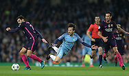 David Silva of Manchester City muscled off the ball by Andre Gomes of Barcelona and Sergio Busquets of Barcelona during the Champions League Group C match at the Etihad Stadium, Manchester. Picture date: November 1st, 2016. Pic Simon Bellis/Sportimage
