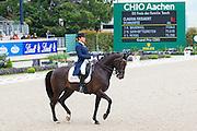 Claudia Fassaert - Donnerfee<br /> World Equestrian Festival, CHIO Aachen 2013<br /> © DigiShots