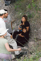 Migrants Connie and daughter Jessica being evaluated by No More Deaths volunteers near the camp in southern Arizona.