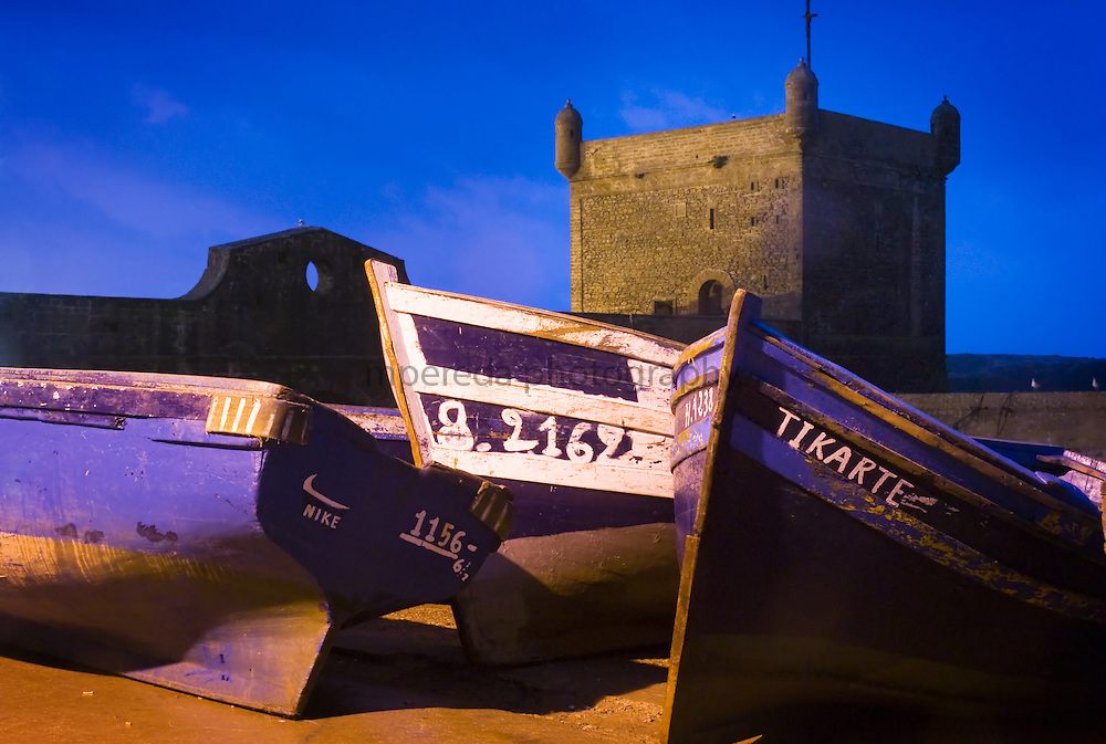 Fishing boats beached in Essaouira Harbour, near the old castle portuguese