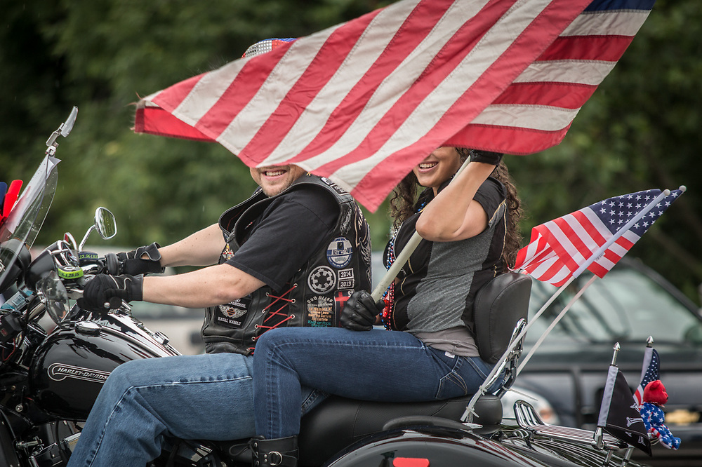 Motorcyclist Dan Burgess with his girlfriend Meagan Holmes ride in Anchorage's Fourth of July parade. phreaktsunami@gmail.com