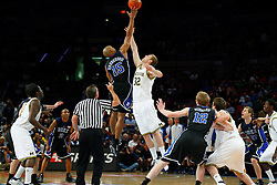 Nov 21, 2008; New York, NY, USA; Duke Blue Devils forward Gerald Henderson (15) and Michigan Wolverines forward Zack Gibson (32) jump for the opening tip during the 2K Sports Classic Championship game at Madison Square Garden.