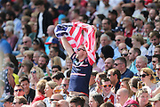 Fan with a stars and stripes flag during the Rugby World Cup 2015 match between Samoa and USA at the Brighton Community Stadium, Falmer, United Kingdom on 20 September 2015.