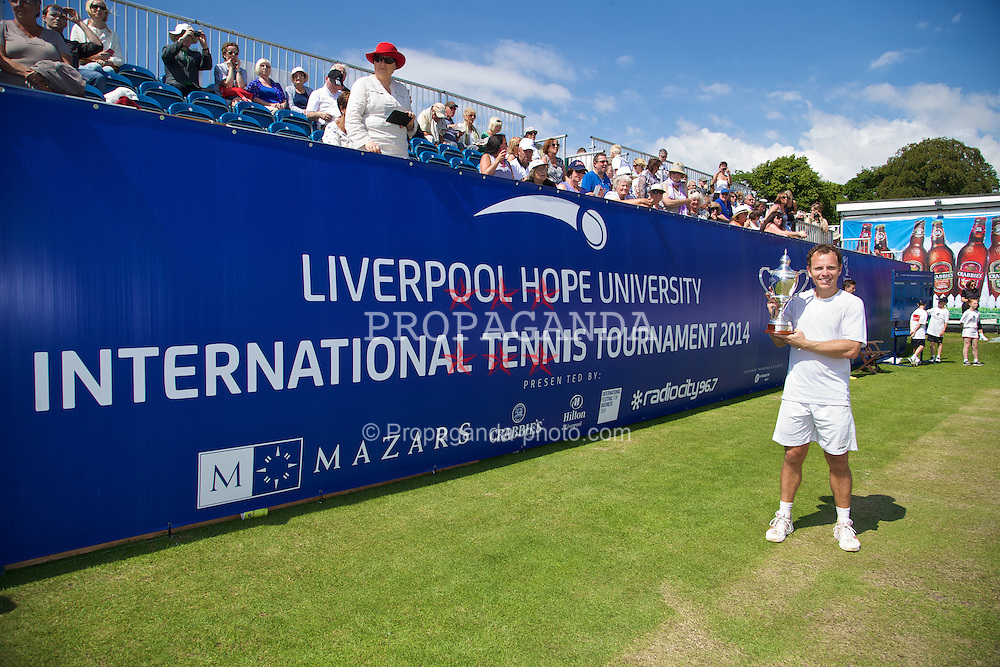 LIVERPOOL, ENGLAND - Saturday, June 21, 2014: Men's Champion Michael Russell (USA) celebrates with the trophy after winning the Men's Final during Day Three of the Liverpool Hope University International Tennis Tournament at Liverpool Cricket Club. (Pic by David Rawcliffe/Propaganda)