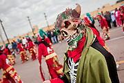 "Dec. 12, 2009 -- PHOENIX, AZ: A ""demon"" performs during a procession to honor the Virgin of Guadalupe at St. Catherine of Siena Catholic Church in Phoenix, AZ. Most of the members of the church are Hispanic and Dec. 12, Virgin of Guadalupe Day, is one of the church's most important holy days. The Virgin of Guadalupe appeared to Juan Diego, a Mexican peasant, on Dec 9, 1531, on a hillside near Mexico City. She is the ""Queen of Mexico"" and ""Empress of the Americas"" and revered throughout Latin America. Matachine dancers do battle with the demon to protect the Virgin of Guadalupe.  Photo by Jack Kurtz"