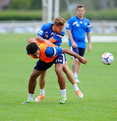 Bristol Rovers' Matt Taylor  battles for the ball with A Trialist  - Photo mandatory by-line: Joe Meredith/JMP - Mobile: 07966 386802 04/07/2014 - SPORT - FOOTBALL - Bristol - Friends Life Sports Ground - Bristol Rovers Pre-Season training
