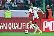Poland's Lukasz Piszczek controls the ball during the EURO 2016 qualifying match between Poland and Germany on October 11, 2014 at the National stadium in Warsaw, Poland<br /> <br /> Picture also available in RAW (NEF) or TIFF format on special request.<br /> <br /> For editorial use only. Any commercial or promotional use requires permission.<br /> <br /> Mandatory credit:<br /> Photo by &copy; Adam Nurkiewicz / Mediasport