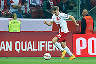 Poland's Lukasz Piszczek controls the ball during the EURO 2016 qualifying match between Poland and Germany on October 11, 2014 at the National stadium in Warsaw, Poland<br /> <br /> Picture also available in RAW (NEF) or TIFF format on special request.<br /> <br /> For editorial use only. Any commercial or promotional use requires permission.<br /> <br /> Mandatory credit:<br /> Photo by © Adam Nurkiewicz / Mediasport