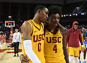 Feb 21, 2019; Los Angeles, CA, USA; Southern California Trojans guard Shaqquan Aaron (0) and guard Kevin Porter Jr. (4) embrace at the end of the game against the Oregon Ducks at Galen Center. USC defeated Oregon 66-49.