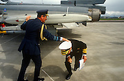An RAF Air Chief Marshal helps a Royal Navy Vice Admiral just before he bangs his head under a new Eurofighter's (Typhoon)  wing