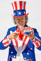 "Uncle Sam holding and pointing at a ""Vote"" button on a white background...Model Release: 20080813_MR_A"