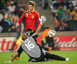 Torres and Itumeleng Khune  during the soccer match of the 2009 Confederations Cup between Spain and South Africa played at the Freestate Stadium,Bloemfontein,South Africa on 20 June 2009.  Photo: Gerhard Steenkamp/Superimage Media.