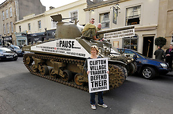 © Licensed to London News Pictures. 09/04/2014; Bristol, UK.  Tony Miles, aka Smiley Miley from the Radio 1 Roadshow, organised a WW2 Sherman tank to drive through local streets in a protest by residents and traders from Clifton Village in Bristol about plans for a Residents Parking Scheme in their area from Bristol's elected Mayor, George Ferguson.  They say the business and social life of the area will be hit very hard by the RPS with customers and visitors unable to park, and that some businesses will have to close or move away from the area.  The tank is a symbol of defending their area against RPS.<br /> Photo credit: Simon Chapman/LNP