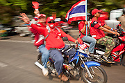 Mar. 28, 2010 - BANGKOK, THAILAND: Red Shirts go to the Royal Thai Army's 11th Infantry Regiment barracks in Bangkok Sunday. More than 10,000 anti government Red Shirt protestor picketed the entrance to the Royal Thai Army's 11th Infantry Regiment Sunday in a continuation of protests that started March 21. The Red Shirts won a key victory Sunday when Thai Prime Minister Abhisit Vejjajiva agreed to negotiate with the protest leaders. The Red Shirts support former Prime Minister Thaksin Shinawatra, who was deposed in a coup in 2006 and went into exile rather than go to prison after being convicted on corruption charges. Thaksin is still enormously popular in rural Thailand. PHOTO BY JACK KURTZ