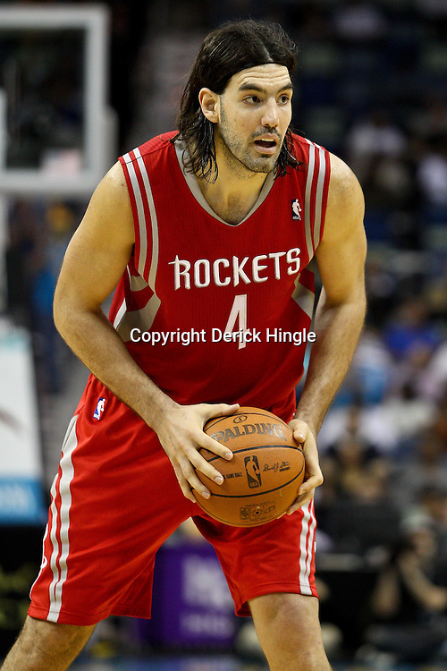 April 6, 2011; New Orleans, LA, USA; Houston Rockets power forward Luis Scola (4) against the New Orleans Hornets during the second half at the New Orleans Arena. The Hornets defeated the Rockets 101-93 and clinched a playoff spot with the victory.   Mandatory Credit: Derick E. Hingle-US PRESSWIRE