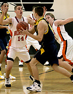 The Wildcats Lucas Smith looks to pass while the Beavers Kyle Eakins (14) defends as the Beavercreek Beavers host the Springfield South High School Wildcats Friday night, February 2, 2007.