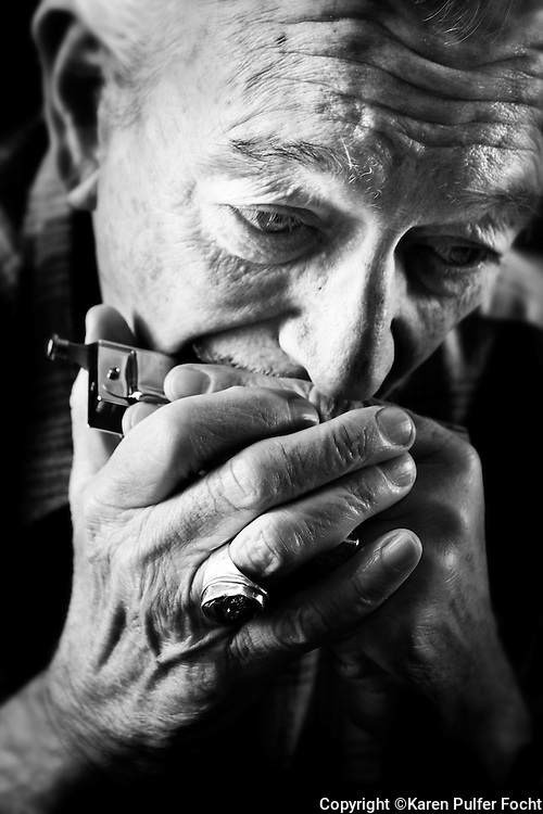 Harmonica great, Charlie Musselwhite plays harmonica in his home town of Clarksdale, Mississippi.