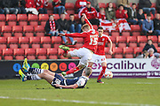 Swindon defender James Brophy is tackled by Millwall FC forward Steve Morison (20) during the Sky Bet League 1 match between Swindon Town and Millwall at the County Ground, Swindon, England on 12 March 2016. Photo by Shane Healey.