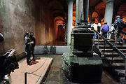 people at the Medusa head inside the Basilica Cistern Istanbul Turkey