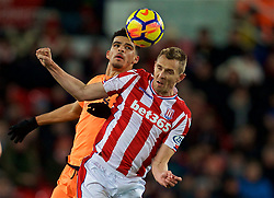 STOKE-ON-TRENT, ENGLAND - Wednesday, November 29, 2017: Liverpool's Dominic Solanke and Stoke City's Darren Fletcher during the FA Premier League match between Stoke City and Liverpool at the Bet365 Stadium. (Pic by David Rawcliffe/Propaganda)