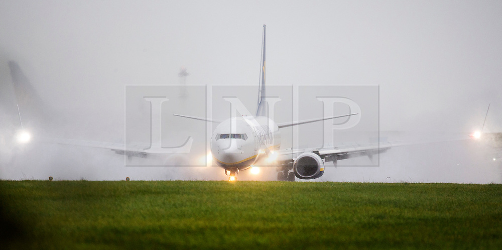 © Licensed to London News Pictures. 11/10/2019. Leeds UK. A Ryanair aircraft is engulfed by water as it lands in heavy rain at Leeds Bradford airport this morning. Photo credit: Andrew McCaren/LNP