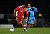 Photo: Richard Lane.<br /> Wycombe Wanderers v Swindon Town. Johnstone's Paint Trophy. 17/10/2006. <br /> Swindon's Ricky Shakes is challenged by Wycombe's Tommy Doherty.
