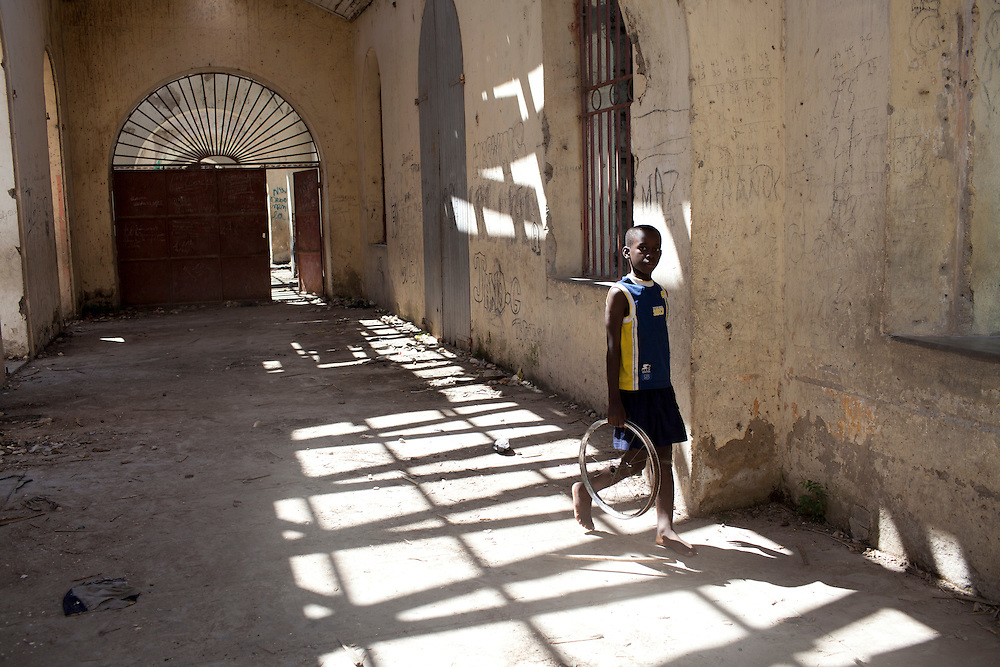 A boy walks through the ruined Palace of 365 Doors on Sunday, October 31, 2010 in Petite Riviere, Haiti.