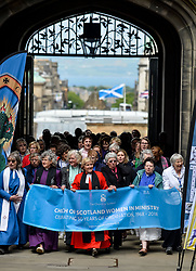 Pictured: Women ministers and supporters march into the quad of the General Assembly, led by former Moderator the Reverend Lorna Hood.<br /> <br /> Women ministers and supporters processed up the Mound in Edinburgh to the General Assembly of the Church of Scotland to mark 50 years since the Church allowed the ordination of women.<br /> <br /> &copy; Dave Johnston / EEm