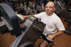 Access to services, Disabled man in the gym; using Ergometer,