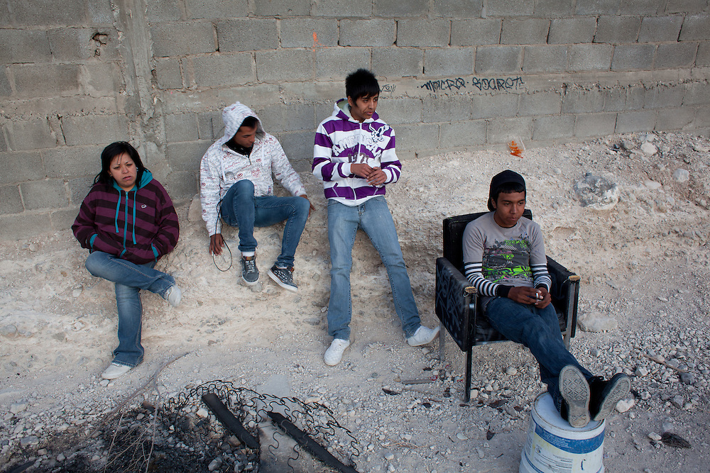 Youth hang out in the Diaz Ordaz colonia, one of the poorest neighborhoods of Ciudad Juarez. The group hangs out out a lookout above the neighborhood to see if outside gangs are coming to attack or rob them, after they had recieved death threats and a series of violent exchanges between neighborhoods left them nervous.