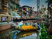 19 NOVEMBER 2018 - BANGKOK, THAILAND: Decorative boats in the canal at the Loy Krathong Fair along Klong (Canal) Ong Ang in Bangkok. This the first public event along the canal. Businesses that line the canal weve evicted about two years and the walkways along the canal were renovated. Loy Krathong takes place on the evening of the full moon of the 12th month in the traditional Thai lunar calendar. In the western calendar this usually falls in November. Loy means 'to float', while krathong refers to the usually lotus-shaped container which floats on the water. Traditional krathongs are made of the layers of the trunk of a banana tree or a spider lily plant. Now, many people use krathongs of baked bread which disintegrate in the water and feed the fish. A krathong is decorated with elaborately folded banana leaves, incense sticks, and a candle. A small coin is sometimes included as an offering to the river spirits. On the night of the full moon, Thais launch their krathong on a river, canal or a pond, making a wish as they do so. The krathongs made at the Klong Ong Ang fair were made out of bread so they would decompose and feed the fish in the canal. Loy Krathong will be celebrated on November 22 this year.    PHOTO BY JACK KURTZ