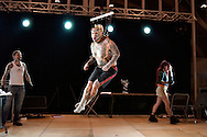 Venezuelan Body Modification artist Emilio Gonzalez is doing a suspension performance at a Tattoo and piercing convention in Mons, Belgium on March 20, 2005. Four steel skewers pierced through the skin and flesh on Emilio's back, must hold his weight and eventually the weight of two extra people while he is lifted from the floor.