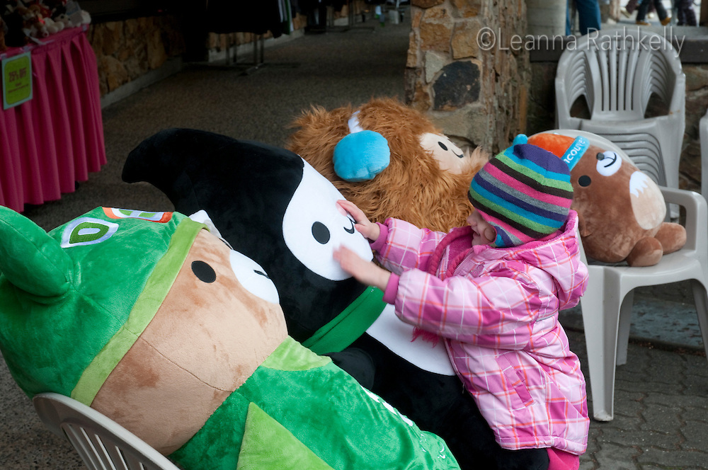 Kids love the 2010 Olympic Winter Games mascots and hug them whenever they can.