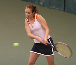 Amanda Rales hits a backhand against Richmond.  Rales won the #6 singles match to help the Hoos to a 6-1 victory.