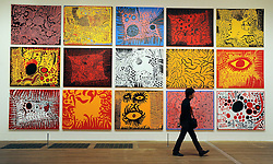 © Licensed to London News Pictures. 07/02/2012, London, UK. A man walks in front of works by Yayoi Kusama. Press preview of Yayoi Kusama at the Tate Gallery Bankside today 7th February 2012. The exhibition spans six decades of the artists work. Kusama is one of Japan's best known living artists.  Photo credit : Stephen Simpson/LNP