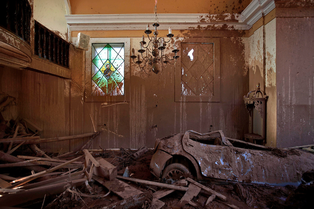 A car, dragged inside a church by a mudslide, is seen in Nova Friburgo, Brazil, Friday, Jan. 21, 2011. <br /> <br /> A series of flash floods and mudslides struck several cities in Rio de Janeiro State, destroying houses, roads and more. More than 900 people are reported to have been killed and over 300 remain missing in this, Brazil&rsquo;s worst-ever natural disaster.