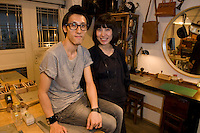 Hoi Ming Fung (R) and her business and life partner Baldwin Pui (L) founders of the leather handbags brand Hoiming in their workshop in Central, Hong Kong.