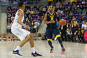 FORT WORTH, TX - JANUARY 4: Jevon Carter #2 of the West Virginia Mountaineers shoots a three-pointer against the TCU Horned Frogs on January 4, 2016 at Ed and Ray Schollmaier Arena in Fort Worth, Texas.  (Photo by Cooper Neill/Getty Images) *** Local Caption *** Jevon Carter