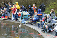 Fishermen and women cats their lines into the water on the first day of trout season at Fanny Chapman Pond Saturday April 2, 2016 in Doylestown, Pennsylvania.  (Photo by William Thomas Cain)